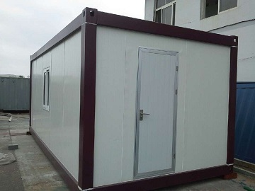 A small white shipping container house.