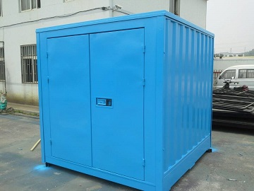 A small blue shipping container house.